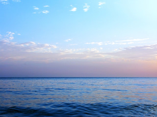 Blue sea ocean horizon sky clouds photo