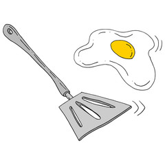 spatula flipping egg