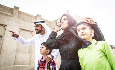 Traditional arabian family walking in the old town