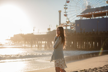 Soft sunlight makes girl glow on beach near Santa Monica Pier