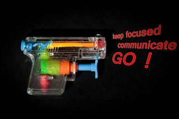 do it symbol - water gun pointing business keywords out focus communicate go