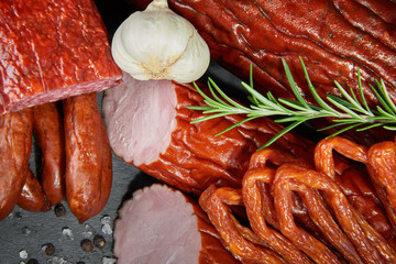 Set of cold cuts on a stone board. Mix of sausages