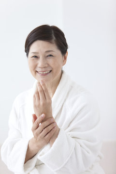 Middle-Aged Woman Caring For Hear Hands