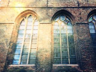 Church windows and brick block wall, Dark grunge tone