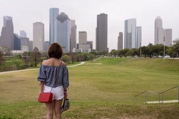A visitor enjoys a view of downtown Houston in TX USA