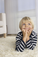 Boy (4-5 Years) lying on floor and looking up