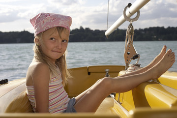 Little girl with bandana in a boat, close-up
