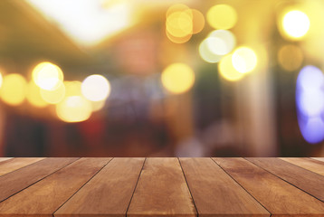 Wood table top with abstract blurred light bokeh background