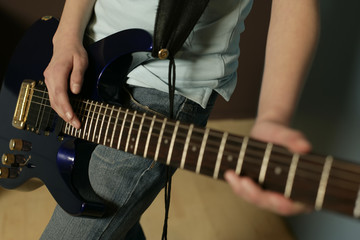 Girl playing an electric guitar