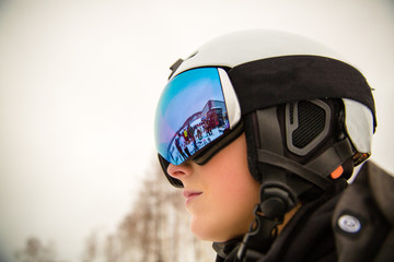 Ski goggles reflecting the chaos of the lift lines