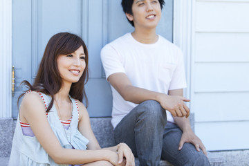 Young Couple Sitting on Step