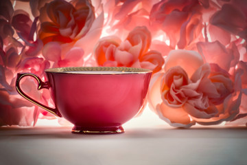 single red teacup on a pink floral background