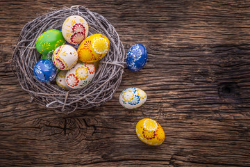 Easter. Hand made easter eggs on old wooden table.