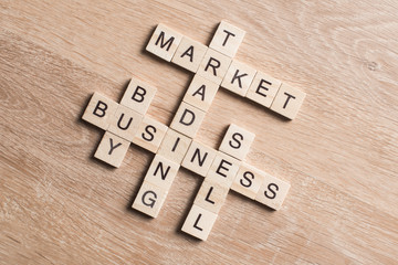 Conceptual business keywords on table with elements of game making crossword