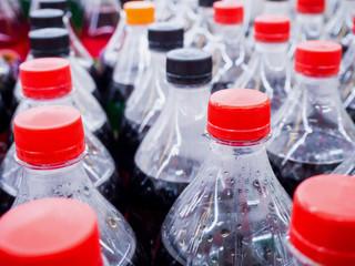 Carbonated soft drink bottles close up