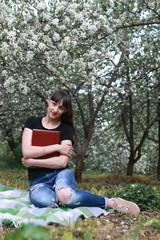 girl in a spring apple flower garden