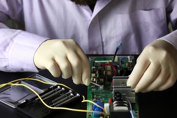 chip soldering man hands