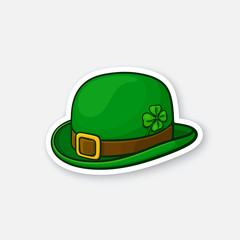 Vector illustration. Green bowler hat with buckle and clover. Saint Patrick's Day symbol. Sticker in cartoon style with contour. Decoration for greeting cards, patches, prints for clothes, badges