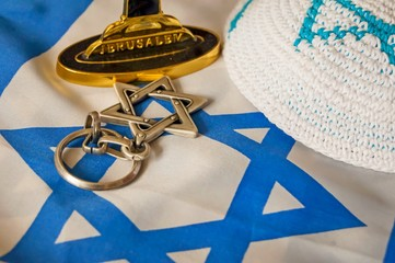 """Jewish symbols: customary religious kippah cap, a Star of David and a foundation of a menorah (a seven-lamp candelabrum) with the word """"Jerusalem"""" written on it. Zionism symbol."""