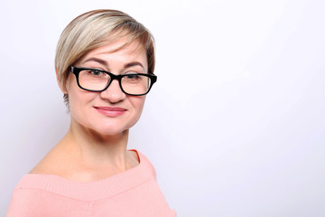 Mature woman wearing glasses on white background