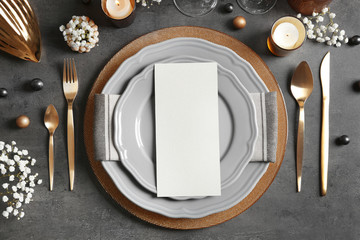 Beautiful table setting on grey background