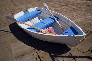 Blue and White Dinghy on a Dock