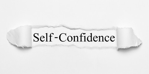 Self-Confidence on white torn paper