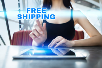 Woman is using tablet pc, pressing on virtual screen and selecting free shipping.