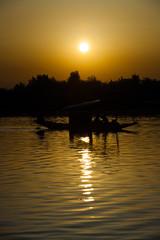 Dal Lake Shikara Boat at Sunset in Srinagar, Kashmir, India. Vertical