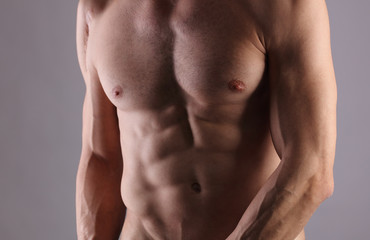 Muscular Men, perfect body, abs, six pack. Strong athletic guy showing his torso. Bodybuilding, sport, fitness ,workout, active lifestyle concept.