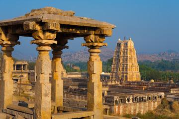 Hampi Stone Gazebo and Virupaksha Temple Tower in Karnataka, India