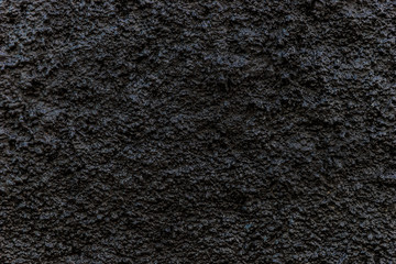 Grain dark painted wall texture background, black background