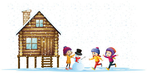 Children playing in snow by the hut