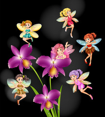 Fairies flying around orchid flowers