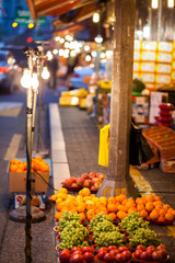 Night fruit store on the sidewalk
