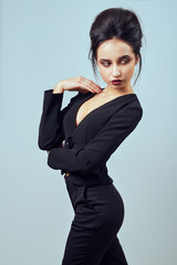 Beautiful sexy woman wear silk velvet suit clothes for businesswoman office style casual girl with dark hair fashion catalog lady perfect face cosmetic and body makeup meeting walk interior room.