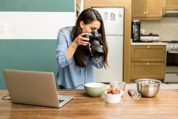 Female food photographer at work