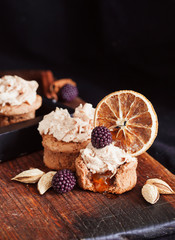 almond and orange cupcake with fresh blackberry