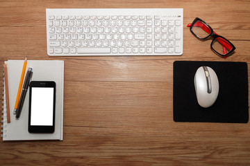 White keyboard with mouse and glasses.