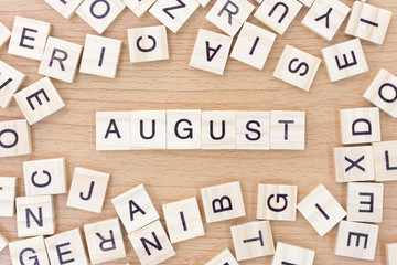 August words with wooden blocks