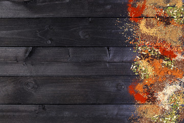 Printed kitchen splashbacks Spices Herbs and spices over black wooden background. Top view with copy space