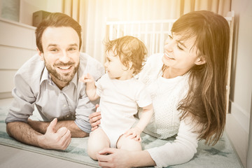 Happy family playing with a baby