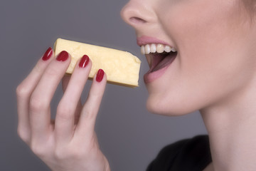 Woman eating a chunk of Cheese