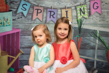 little girls on spring and easter backdrop