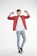 Vertical image of cool man showing biceps