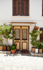 photo of beautiful door of one of the buildings in sunny Greece