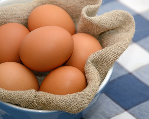 Brown Eggs in bowl with sackcloth fabric