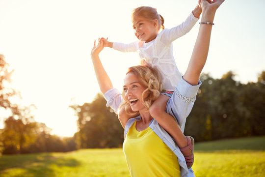 Happy mother with daughter enjoying