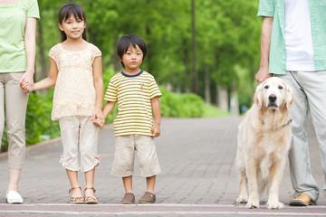 Family walking dog