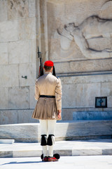 ATHENS, GREECE - JUNE 06, 2016: photo of evzone from the back  in front of the Tomb of the Unknown Soldier in Greece